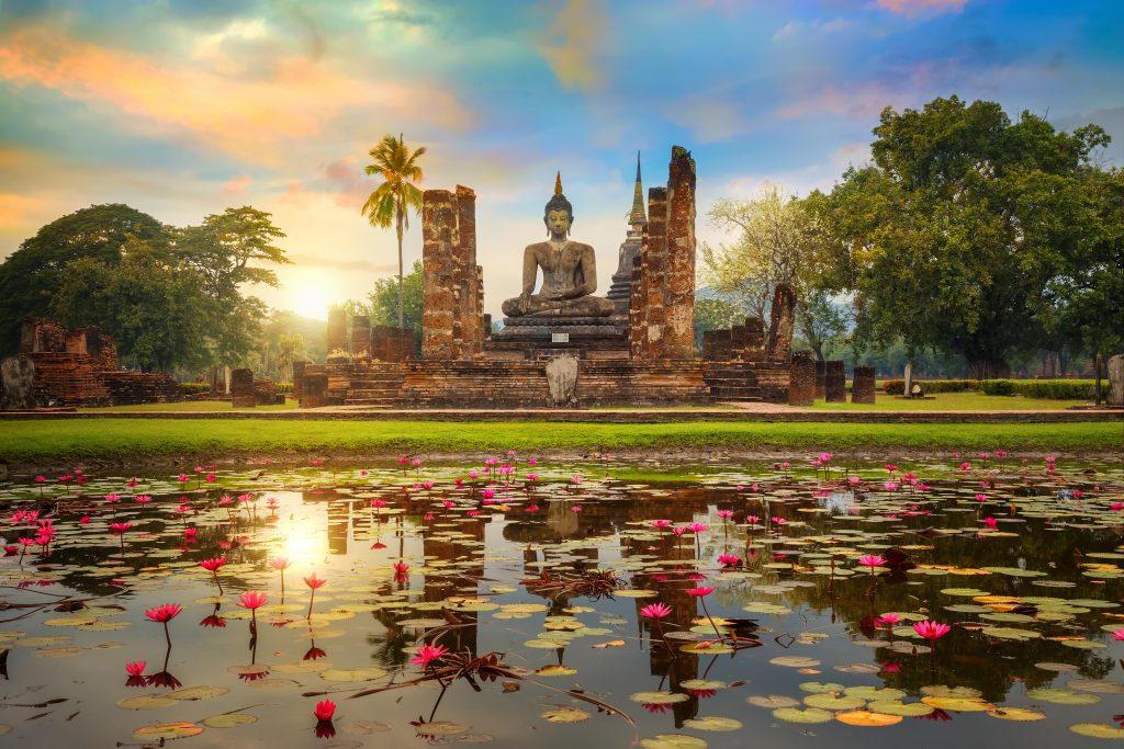 Wat Mahathat Temple in the precinct of Sukhothai Historical Park, a UNESCO World Heritage Site in Thailand  SUKHOTHAI, THAILAND - JANUARY 18 2017: Wat Mahathat Temple in the precinct of Sukhothai Historical Park, a UNESCO world heritage site.